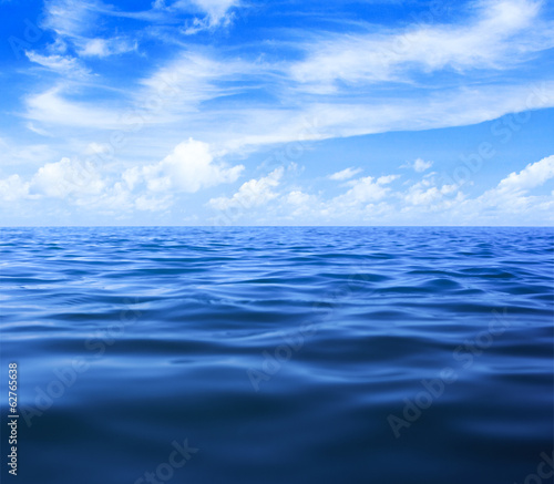 In de dag Zee / Oceaan sea or ocean water surface with blue sky and clouds