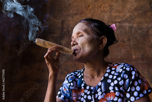 happy smoking old woman in myanmar