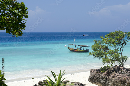 Foto op Canvas Zanzibar Beach and boat on turquoise water in Zanzibar, Tanzania, Africa