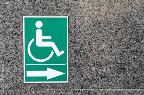 Valokuva  Label sign of cripple on marble wall.