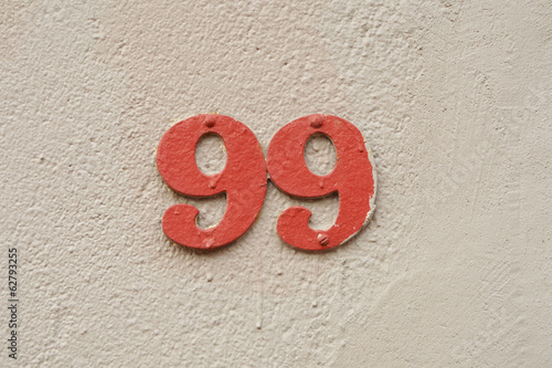 Photographie  House Number ninety-nine sign