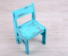 Blue Old Wooden Chair On Wooden Floor