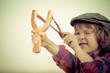 Kid holding slingshot