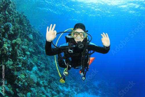 Canvas Prints Diving Young woman scuba diving having fun