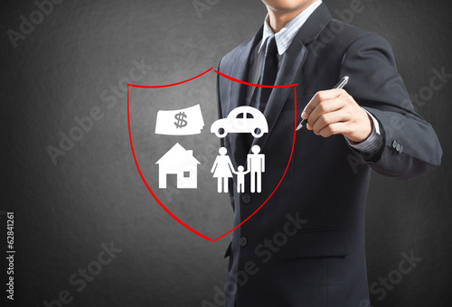 Fotografie, Obraz  Business man drawing shield protecting family, insurance concept