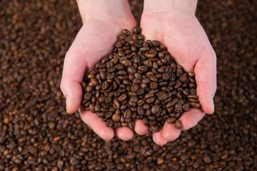 Panel Szklany Do kawiarni a hand full coffee