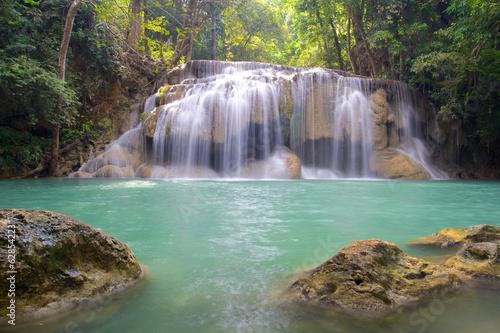 Poster Bleu nuit Waterfall in Erawan National Park with rocks