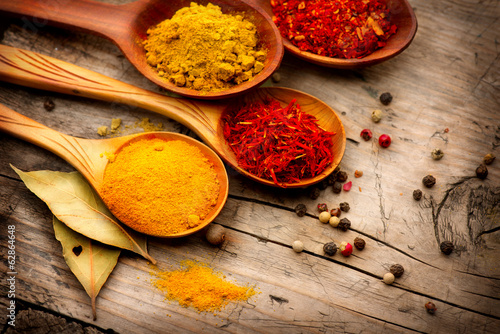 Canvas Prints Spices Various spices and herbs over wooden background