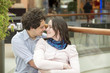 Love couple in shopping center hugging
