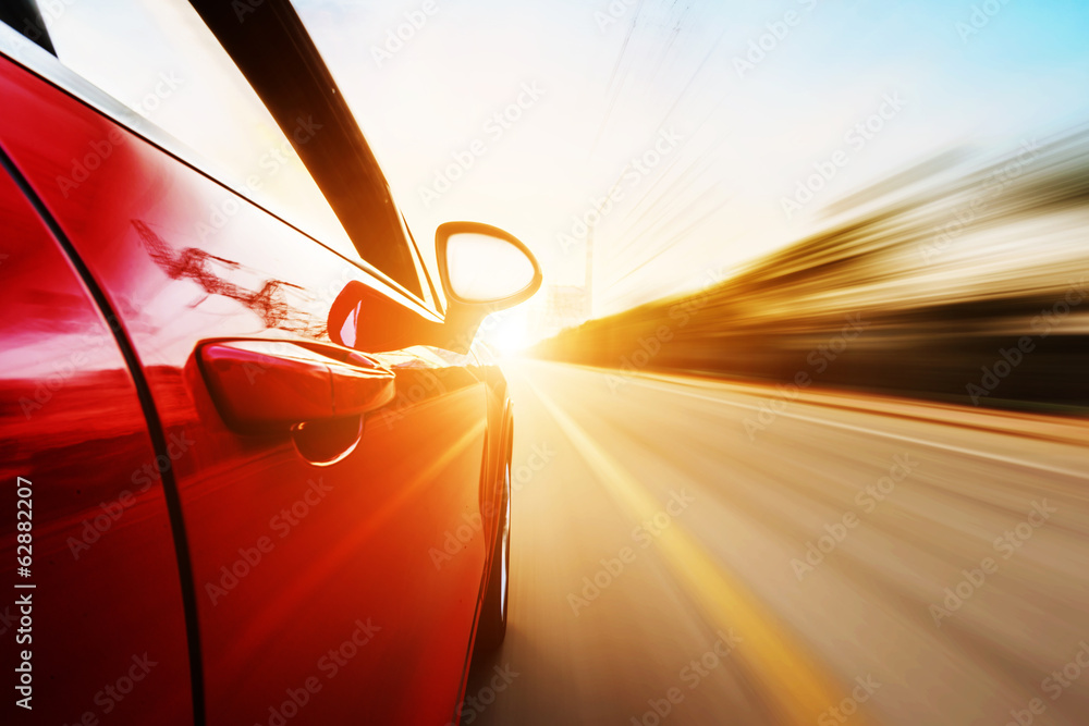 car driving on a motorway at high speeds