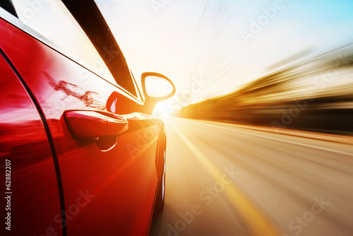 car driving on a motorway at high speeds Wallpaper Mural