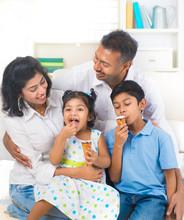 Indian Family Enjoying Eating ...