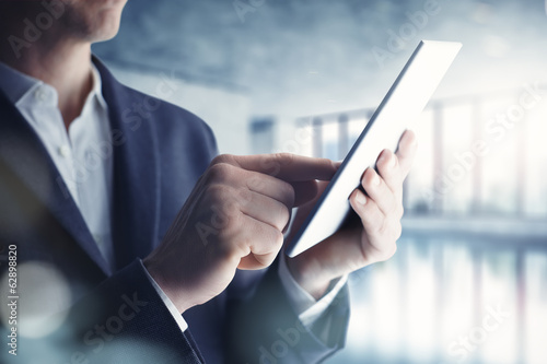 Fotografia  Businessman with tablet computer