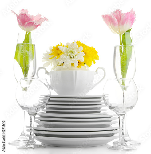 Deurstickers Klaar gerecht Stack of white ceramic dishes and flowers, isolated on white