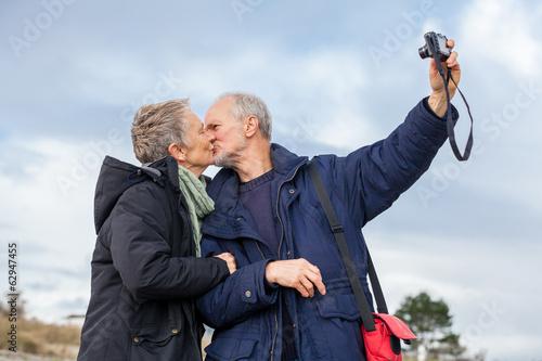Obraz na plátně Elderly couple taking a self portrait