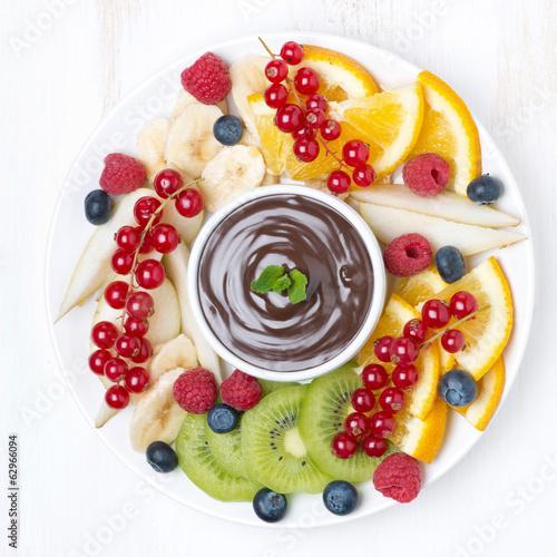 Foto op Aluminium Vruchten assorted fruit with chocolate sauce, top view
