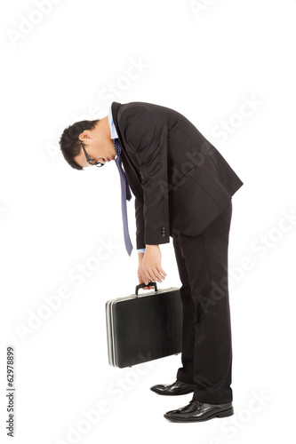 Fotografie, Obraz  exhausted businessman stoop and holding briefcase
