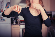 Woman With Dead Mouse In Kitchen