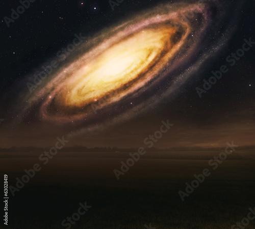 Galaxy over field.