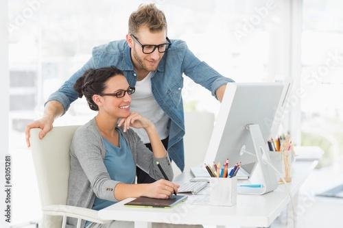 Fotomural  Young design team working at desk