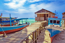 Fishing Boats And Hut At The Seaside