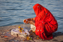 Indian Woman Performs Morning ...