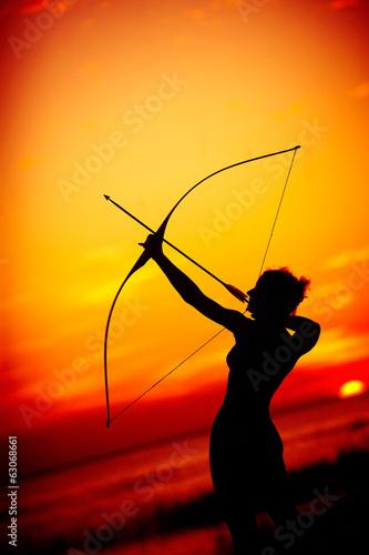 Vászonkép Sexy nude archer at sunset