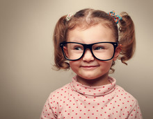 Funny Kid Girl In Glasses Looking On Empty Copy Space