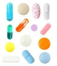 Group Individually Isolated Pills Over A White Background