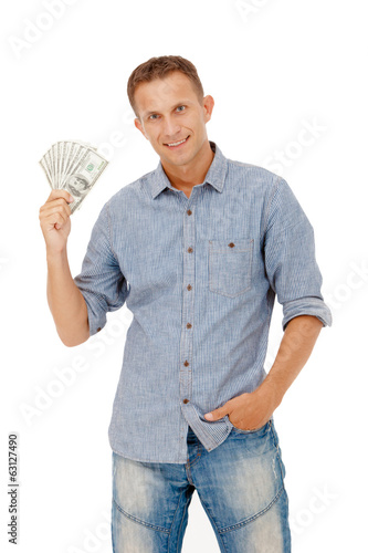 Fotografering  A young man holding a wad of cash up in his fist