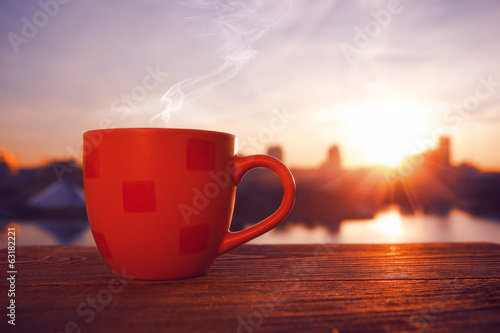 morning coffee with city view in sunrise Poster