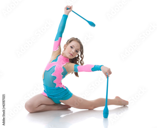 Tuinposter Gymnastiek Adorable girl exercising with gymnastic mace