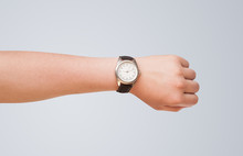 Hand With Watch Showing Precis...