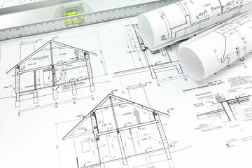 Blueprint with rolls and spirit level