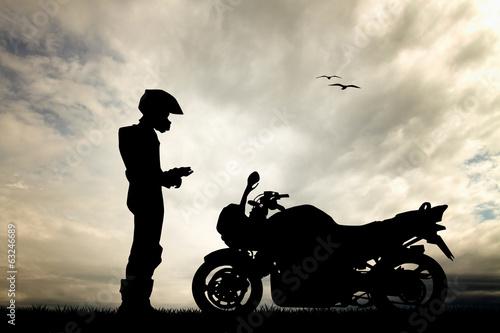 Valokuvatapetti motorcyclist at sunset