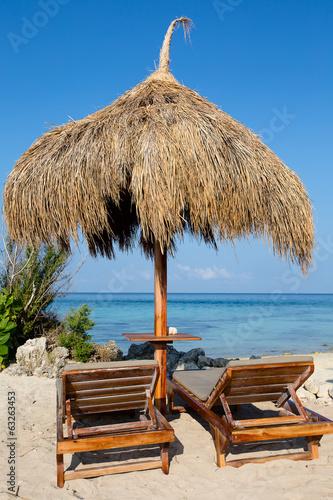 Poster Tunesië Beach chair at sunny coast. Island Malapascua, Philippines
