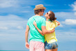 back view of happy young couple in sunglasses having fun on