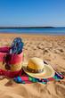 sunbathing accessories on sandy beach