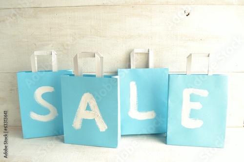 Photo  Light blue bargain sale shopping bags