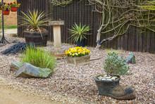 Urban Rockery Garden With Grasses And Shrubs.