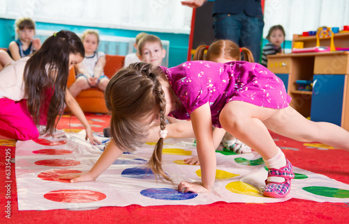 Fotografie, Obraz  Cute toddlers playing in twister game