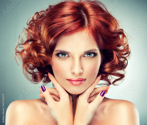 Beautiful model red with curly hair Fotobehang
