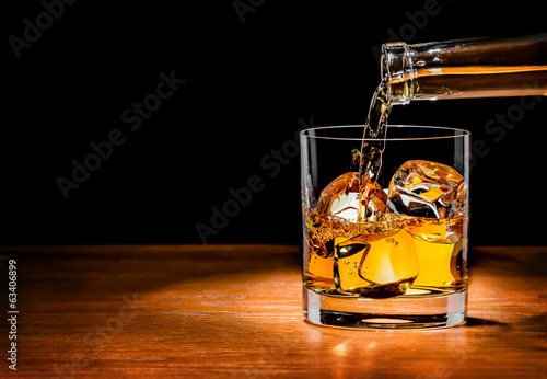 Fotografie, Obraz  Pouring whiskey drink into glass