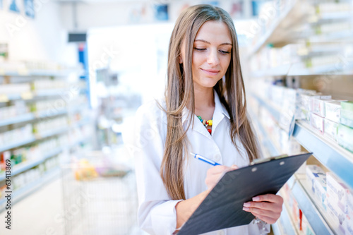 Papiers peints Pharmacie portrait of blonde pharmacist or health care worker