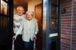 canvas print picture - elderly couple opening the front door