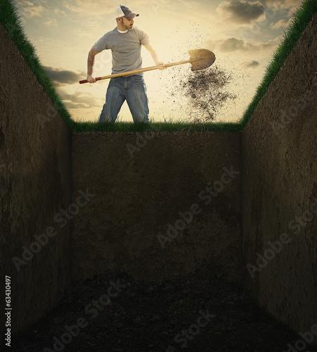 Photo  Dirt into a grave.