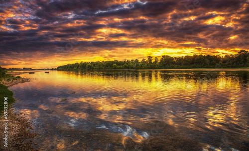Foto op Aluminium Diepbruine Sunset on the Loire River in France