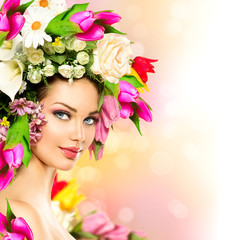 Fototapeta Do fryzjera Spring woman. Beauty model girl with colorful flowers hairstyle