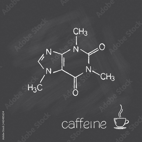 Photo  Caffeine molecule and cup of coffee chalked on blackboard