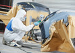 auto mechanic painting car bumper